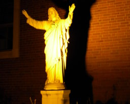 Sacred Heart of Jesus Statue at Night